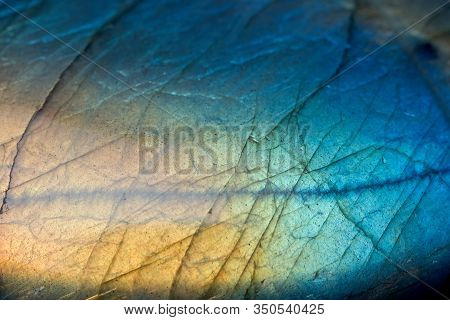 Full Frame Of Green Blue And Yellow Labradorite Crystal Stone Surface Background.