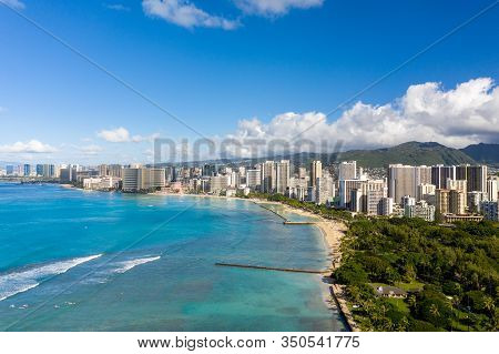 Aerial Drone View Of The Sea Front On Waikiki With Honolulu In The Background