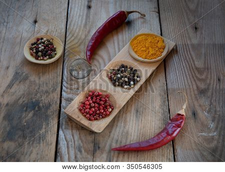 Collection Of Aromatic Herbal Spices And Red Pepper For Flavouring And Seasoning For Healthy  Salads