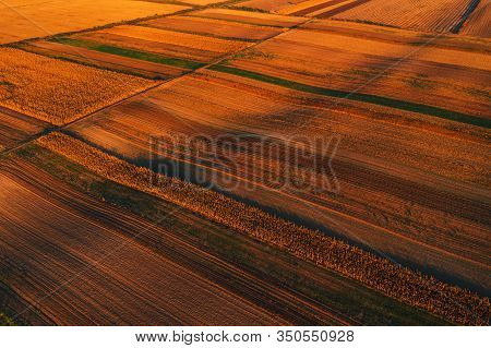 Colorful Countryside Patchwork Background, Cultivated Agricultural Field As Abstract Pattern In Autu
