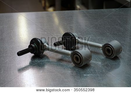 Stabilizer Rods Of Front Or Rear Suspension Of A Modern Car On A Steel Background. New Original Qual