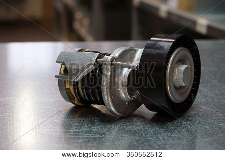 Engine Parts Of A Modern Car. Tension Roller Of A Drive Belt . New Original Quality Spare Parts. Tra