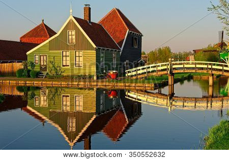 Old Dutch Industrial House Reflecting In Water