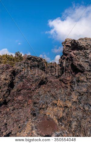 Kilauea Volcano, Hawaii, Usa. - January 9, 2012: 1961 Pile Of Black, Rust And Brown Lava Under Blue