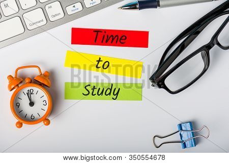 Alarm Clock And Workplace With Text Time To Study. The Concept Of Education And Continuous Personal