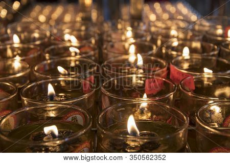 Johor Bahru, Malaysia- 27 Jan, 2020: Candlelight Floating Oil Lamps Illuminate Belief That If People