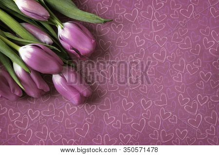 Pink Tulips With Heart Symbol Pink Background With Copy Space. Top View. Valentines Day Or Anniversa