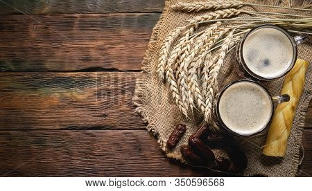 Dark Beer In The Mug On The Wooden Table Background With Copy Space.