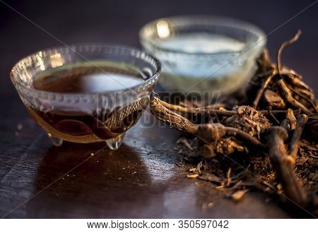 Raw Ayurvedic Herb Chitrak/plumbago Zeylanica Roots On The Brown-colored Shiny Surface With Some But