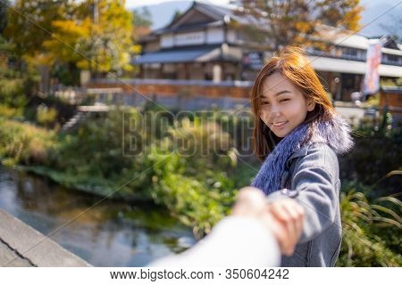 Cute Girl With Vintage Cloath Standing Next To The Bridge Around Area Of Old Down Town At Yufuin. Ty