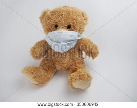 Teddy Bear With Protective Face Mask On White Background