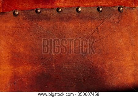 old  weathered leather tacked on wood background