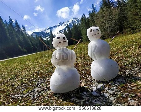 Snowman. Snowmen On The Grass. With Mountain Background. Tatry Slovakia. Do You Want To Build A Snow