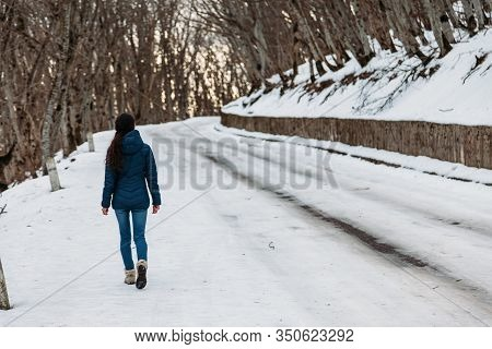 Man Walks Along The Mountainside In Forest
