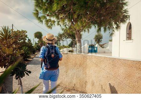 Santorini Traveler Exploring Discovering Greek Architecture In Akrotiri. Woman Backpacker Walking Du