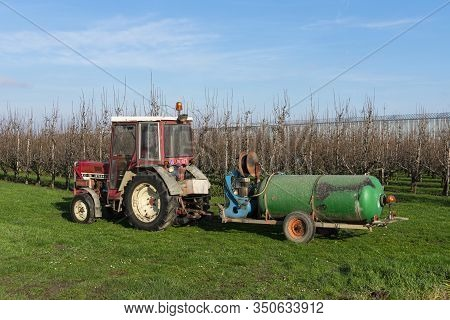 Sint Gillis Waas, Belgium January 16, 2020, Tractor With Dung Cart Ready To Spray The Field With Man