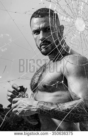 Mental Problem. Bullet Hole In Glass. Broken Glass Because Of Hit. Sexy Hispanic Man Broken Mirror.