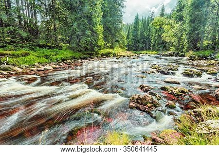 River Runs Over Boulders In The Primeval Forest