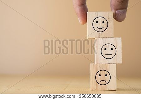 Hand Select And Putting Smile Cube Emotion For Stacking To Normal And Sad Emotion Wooden Cubes.excel