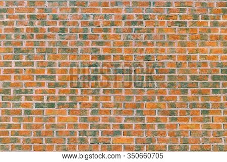 The Wall Of The Building Is Made Of Dark, Red To Brownish Clinker Brick With Various Alternating Pat