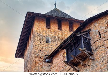 Medieval Castle Wall With Tower And Wooden External Embrasure.