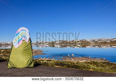 Portable Shower Bath Tent On Norwegian Nature. National Tourist Hardangervidda Route. Camping Touris