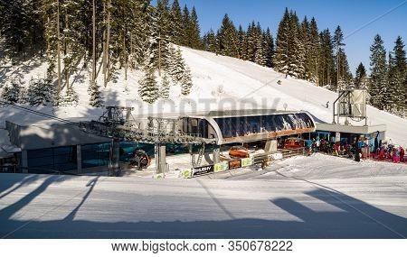 Demanovska Dolina, Slovakia - February 8: Ski Lift Chair And Skiers In Ski Resort Jasna In Low Tatra
