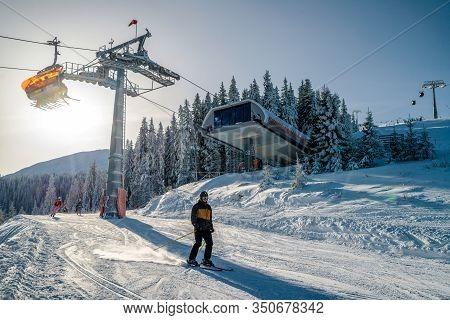 Demanovska Dolina, Slovakia - February 8: Ski Lift Chair Top Station Zahradky And Skier On Slope In