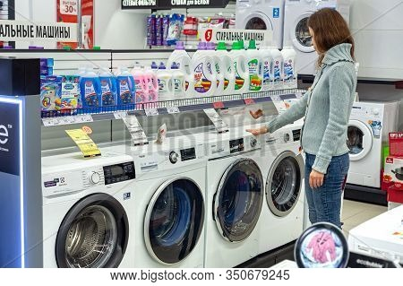 Minsk, Belarus - January 29, 2020: Woman Chooses Washing Machine In The Shop Of Home Appliances. Was