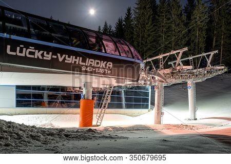 Demanovska Dolina, Slovakia - February 8: Empty Ski Lift Chair At Night In Ski Resort Jasna On Febru
