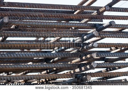Steel Reinforcement Bars. Reinforced Iron For Concrete Construction. Closeup Of Rebars