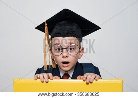 Surprised Boy In Glasses Wearing Student Hat. Middle School, Junior High School