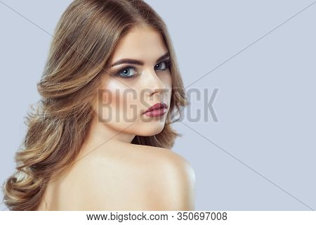 Portrait Of A Beautiful Woman With Long Eyelashes, Beautiful Make-up, Thick Eyebrows And With Clean