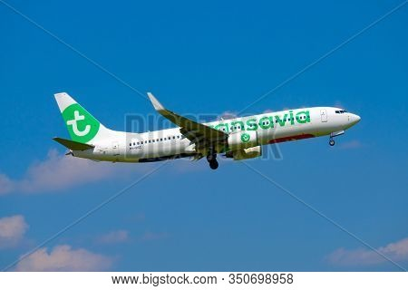 Zurich, Switzerland - July 19, 2018: Transavia airlines airplane preparing for landing at day time in international airport, cloudy sky at background