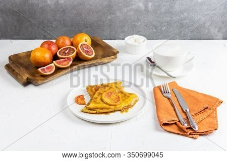Serving Breakfast For One Person. On The White Table Are Plate With A Crepe Suzette, Cup Of Cappucci
