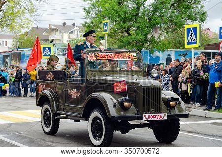 Anapa, Russia - May 9, 2019: Veterans Ride The Streets Of The City Of Anapa In An Old Restored Milit