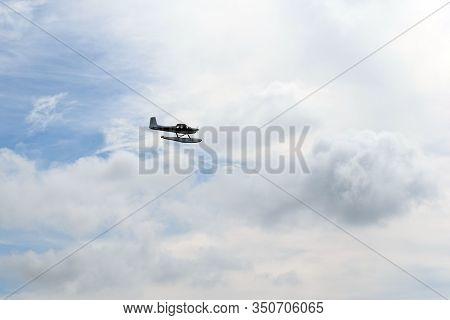 The Amphibian Seaplane Comes In For Landing. Aircraft In The Sky