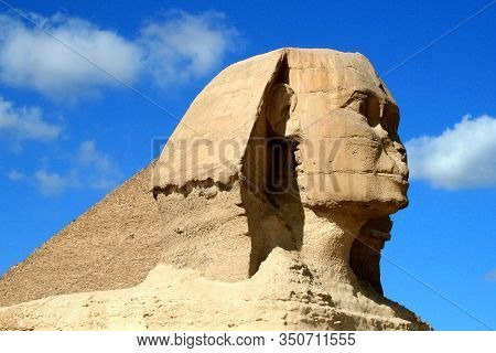 Sphinx Head Against A Very Beautiful Sky. Egyptian Sphinx In Egypt Close-up, Giza, Egypt