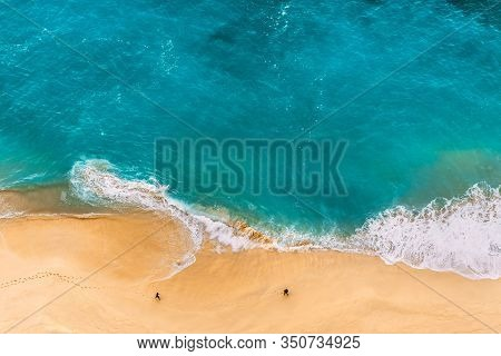 Beautiful Indian Ocean, Bali, Indonesia. Beautiful Sandy Beach With Turquoise Sea. Drone View Of Tro