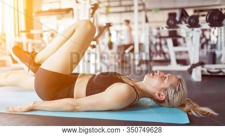 Woman doing fitness workout gymnastics as a workout in the fitness center