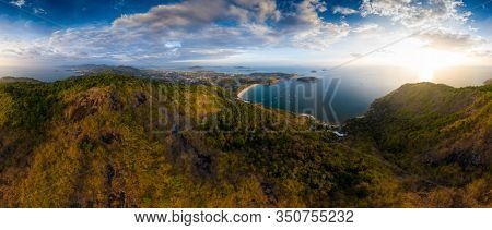 Aerial panorama of Phuket island in Thailand. Aerial panorama of the southern area of the island of Phuket with Nai Harn beach (in the center) during sunset