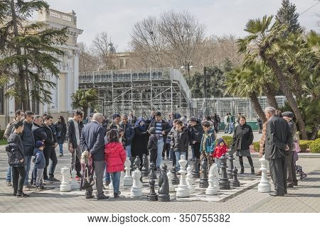 Baku, Azerbaijan-march 25, 2018; Large Chess Field In The Seaside Park.  People Who Are Passionate A