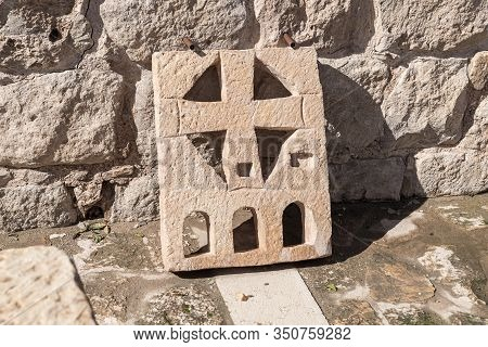 Jerusalem, Israel, January 25, 2020 : Well-preserved Stone With A Cross Carved In It In The Yard Of