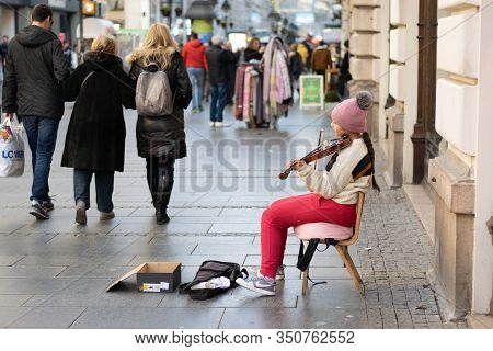 Belgrade,serbia-13.02.2020. Young Street Musician Lifestyle. Young Girl Musician Playing On Street.