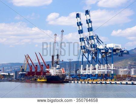 Novorossiysk, Russia - August 01, 2019: Cargo Cranes At The Berths Of The Novorossiysk Port