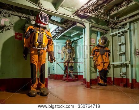 Novorossiysk, Russia - August 01, 2019: Figures In Diving Suits In The Corridors Of The Cruiser-muse
