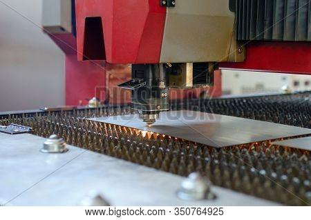 Industrial Fiber Laser Cutter. Plasma Cutting Of Metal. Sparks Flying From Laser