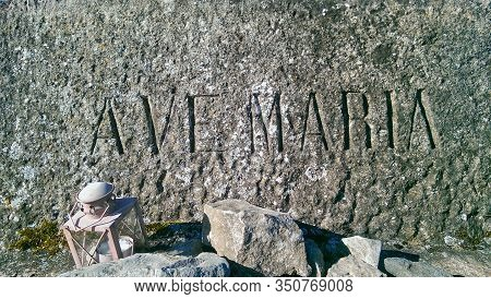 Ave Maria Engraved On A Stone, Lantern In The Foreground.