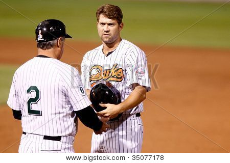 CENTRAL ISLIP-JULY 21: Long Island Ducks outfielder Reid Gorecki and hitting coach Jay Loviglio (2) against the Sugar Land Skeeters on July 21, 2012 at Bethpage Park in Central Islip, New York.