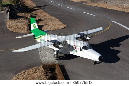Lukla, Nepal - January 19, 2017: Aircraft Landing On Tenzing - Hillary Airport Runway In Himalaya